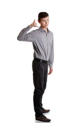 Young businessman showing call me sign