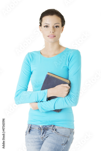 Happy student woman with book