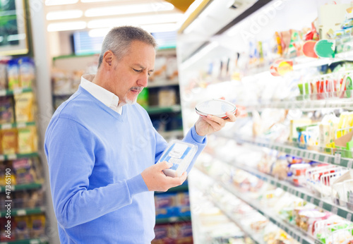 Customer comparing products in a supermarket