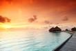 maldivian houses on sunrise