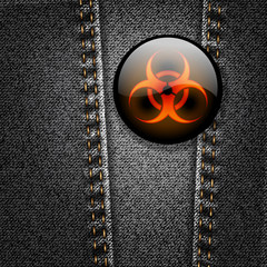 Biohazard badge on black denim vector