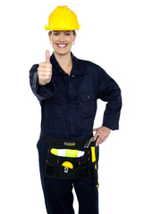Confident lady worker showing thumbs up