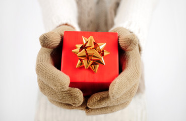 Red gift in hands