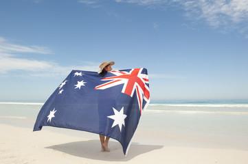 Attractive woman Australian flag at ocean beach