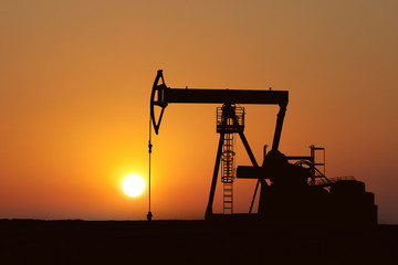 oil pump silhouette in sunset