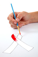 Hand painting an AIDS ribbon