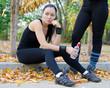 Female athlete resting while training