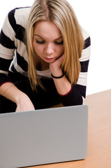 Woman concentrating as she uses her laptop