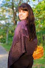 Attractive woman carrying a basket