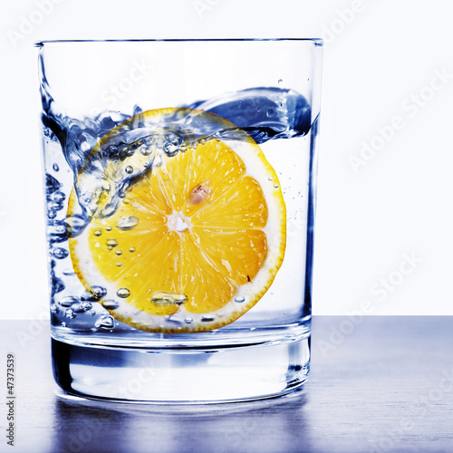 canvas print picture Glass of water with lemon