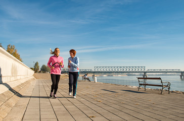 Mother and daughter jogging on coasts