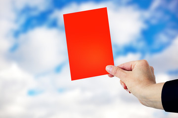 Hand showing red card