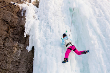 Wiman climbing frozen waterfall