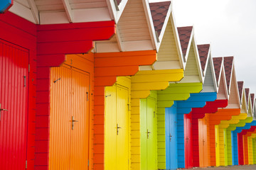 Multicoloured beach huts.