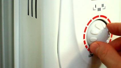 Turning button on electric radiator.