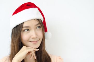 Portrait of Asian christmas girl wearing santa hat.