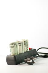 Mehrfachsteckdose mit Geld