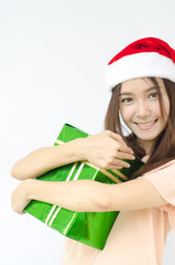 Smiley Asian woman in santa hat hold a box gift on her hand.