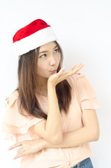 Young beauty Asian girl with santa hat .