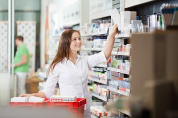Pharmacist Stocking Shelves