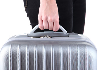 Holding suitcase in hand isolated on white
