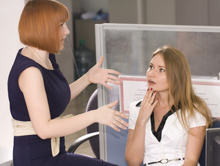 Young girls talking in the office