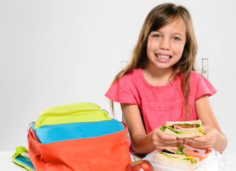 Elementary school girl about to eat her packed lunch
