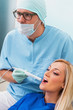 Dentist examines teeth of the patient with teeth-camera