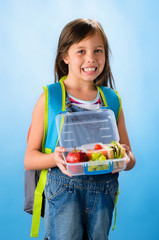 Cute school girl shows her healthy lunch box