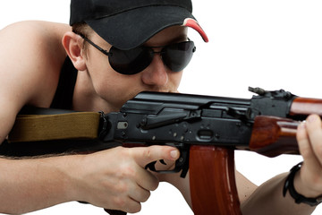power man with Kalashnikov and glasses