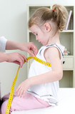 Pediatrician measuring toddler's chest