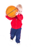 little boy playing with basketball