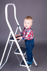 little boy on ladder in the studio