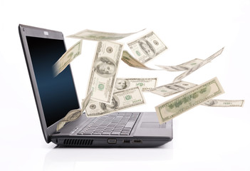Money falling from laptop screen, blurred motion