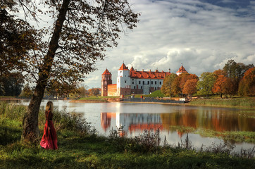 Castle by river in autumn