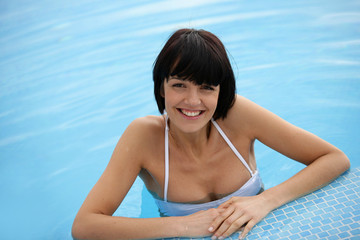 Brunette stood in swimming pool