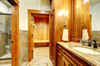 Luxury mountain home bathroom inetrior with stone and wood.