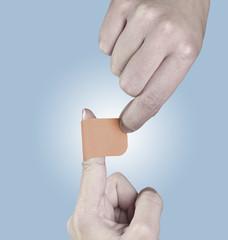 Adhesive Healing plaster on hand.