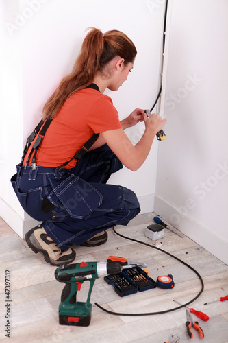 Electrician installing electrical wiring