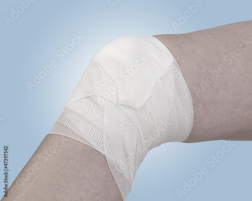 Cotton bandage over a wound on knee.