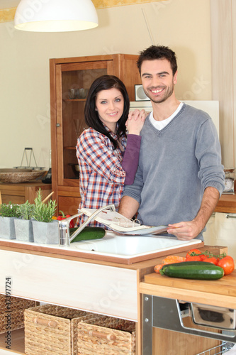 Happy couple in the kitchen