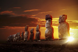 Mysterious stone statues at dramatic sunrise