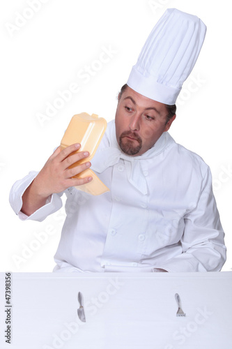 Chef looking into empty burger box