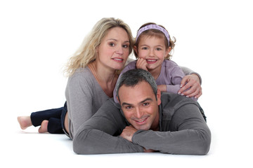 Studio shot of parents with their daughter
