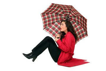 Scottish woman sitting with umbrellas