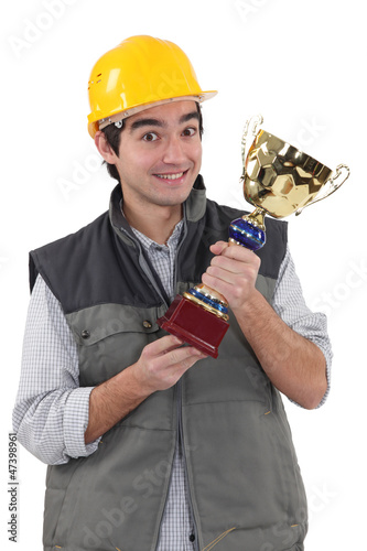 Worker with sports drink in their hand