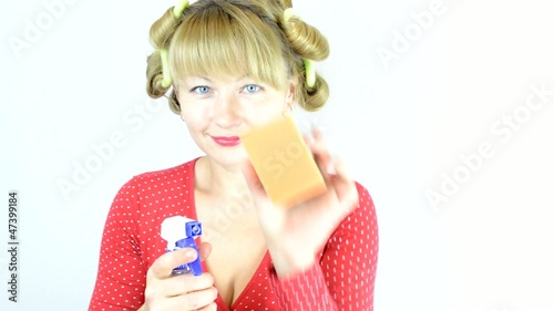 Housewife with detergent and a sponge