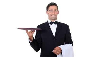 Waiter with tray smoking and balance