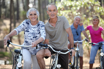 Mature couples on a double date biking.