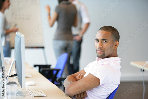 Man sitting back in an office